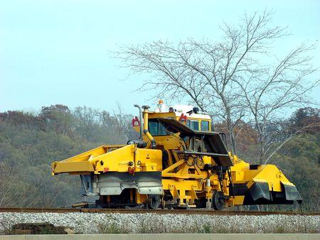 heavy machinery: Heavy machinery repairing the train tracks