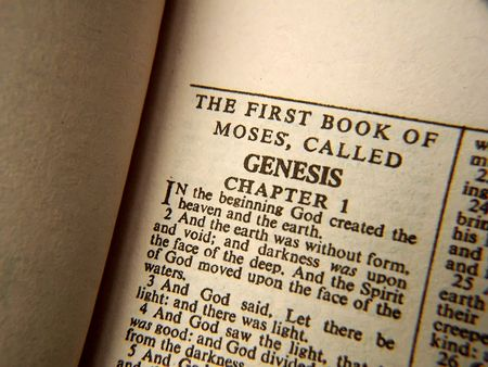 bible opened in the book of Genesis, chapter one from the old testament
