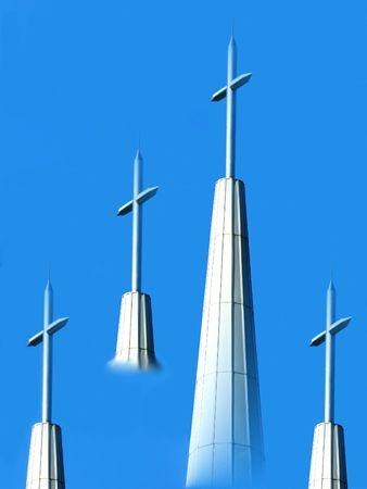 metal crosses against the blue sky