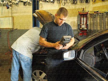diagnosing: Royalty free stock photo of auto mechanics at work