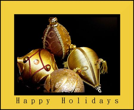 free stock: Free stock photo of gold Christmas ornaments, isolated over black, closeup. Image done as greeting card with gold border and text Happy Holidays