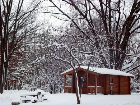 log cabin winter: Stock photography of a log cabin in the woods, snow scenery Stock Photo