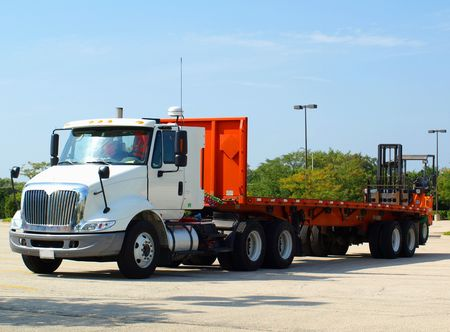 Free royalty photo of a white truck with a long platform