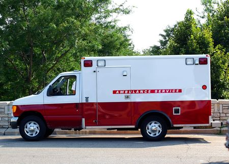 Photo of an ambulance painted in white and red
