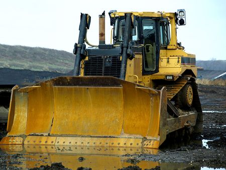 Royalty free stock photo of two yellow huge construction machines