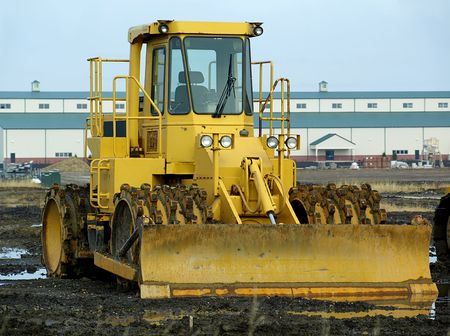 plow: Stock free royalty image of a large caterpillar with plow on a muddy field Stock Photo