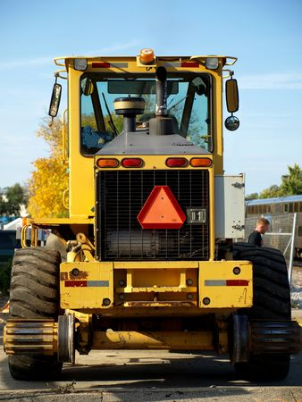frontal: Stock photo, frontal view of a yellow bulldozer on a construction site Stock Photo