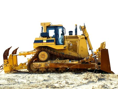 Stock photo of a yellow bulldozer on a construction site, partially isolated over white