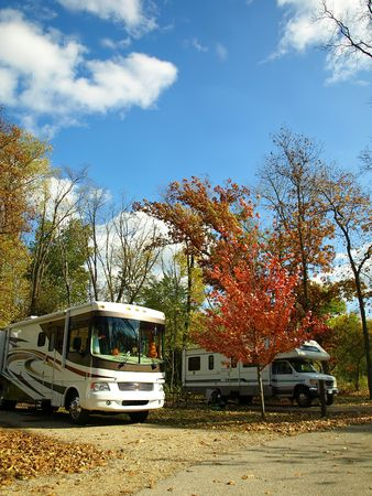 homes: Motor homes park on a campground on a fall sunny day with blue sky
