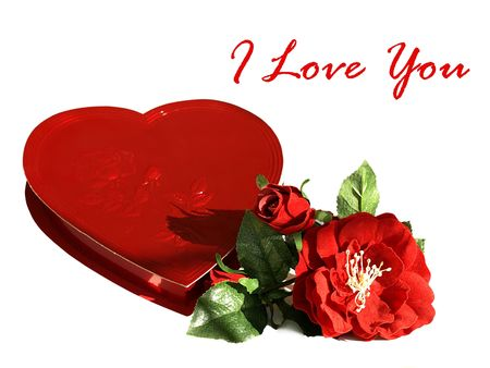 Photo of a heart shaped red box of chocolates with silk red roses and the text I love you