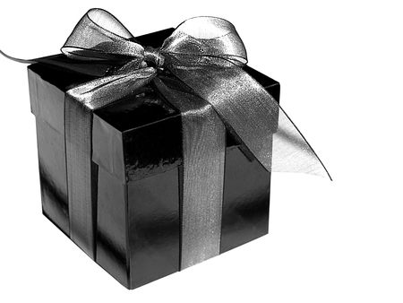 Picture in black and white of a gift box with a silver bow, isolated over white