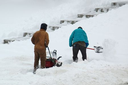 snow clearing: Men clearing snow Stock Photo