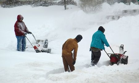 clearing the path: Men clearing snow Stock Photo