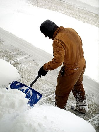 Royalty free photo of a man shoveling snow