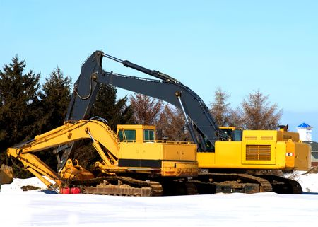 Stock photo of a yellow excavator on a construction site photo