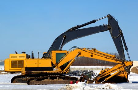 Stock photo of a yellow excavator on a construction site