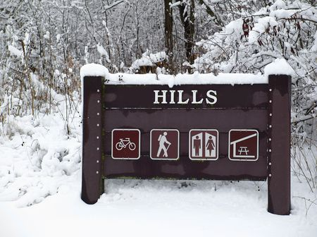 Stock photography of camping sign in the woods, winter scenery
