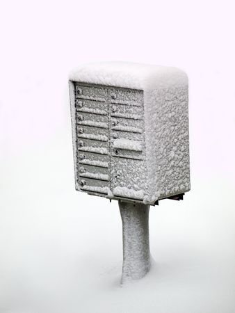 Image of a snowy cluster mail boxes