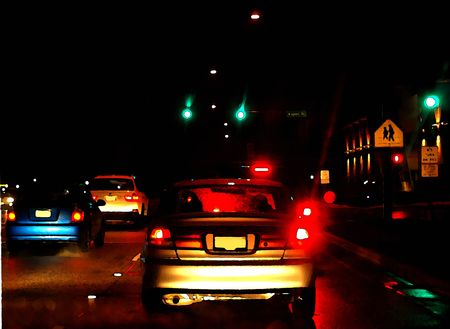 tail light: Ink over watercolor of brake lights of cars stopped at red traffic light, on a wet and rainy night