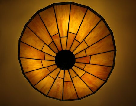 lite: Photo of a beautiful lit Tiffany style ceiling lamp in warm and bright colors Stock Photo