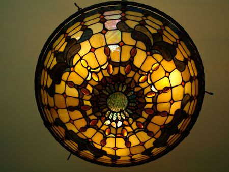 Photo of a beautiful lit Tiffany style ceiling lamp in warm and bright colors Stock Photo - 4816541