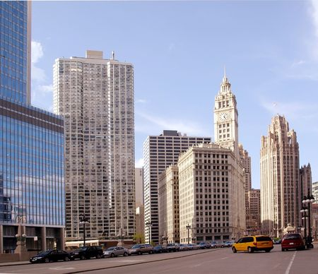 Stock photo of a street in downtown Chicago at sunset, with the sun hitting  the buildings on one side photo