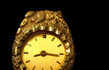 Photo print, close up of a gold woman's wrist watch isolated over black Stock Photo - 5022219