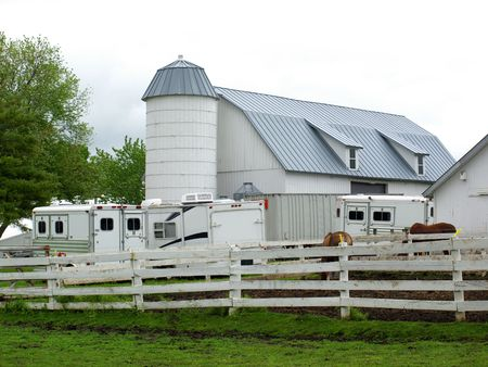 Photography of a white horse stable compound, out in the country, rural setting
