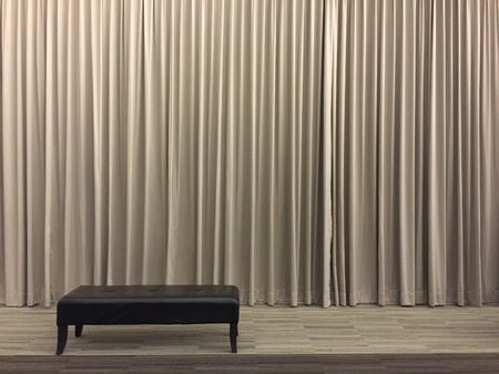 lonliness: Plain taupe color curtain Stock Photo