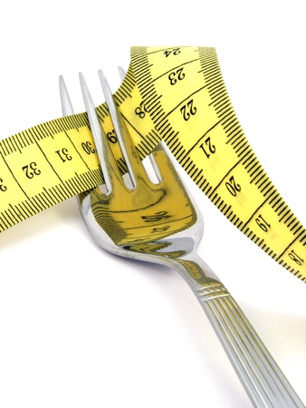 weight loss plan: Fork with yellow measuring tape - Healthy life concept Stock Photo