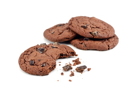 Chocolate chip cookies with bite missing on a white background photo