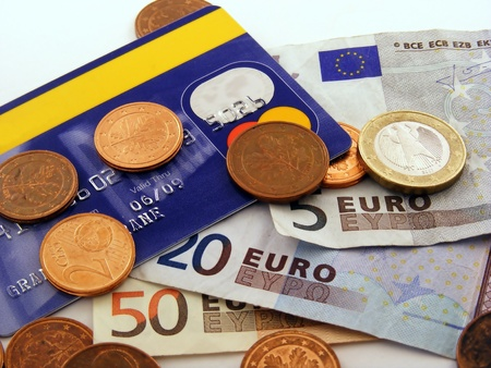 cash card: Close up of a credit card with euro money notes & coins