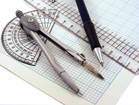 protractor: A compass,pen,protractor & ruler on a sheet of graph paper. Stock Photo
