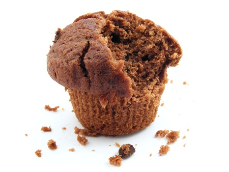 missing bite: A chocolate muffin with a bite missing