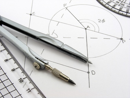 protractor: A geometrical themed image with a geometry diagram & utensils Stock Photo