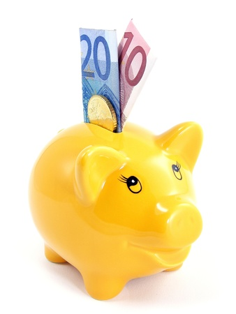 A piggy bank with euro currency on a white background  photo