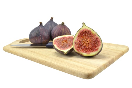 purple fig: Fig fruit on wooden board with white background