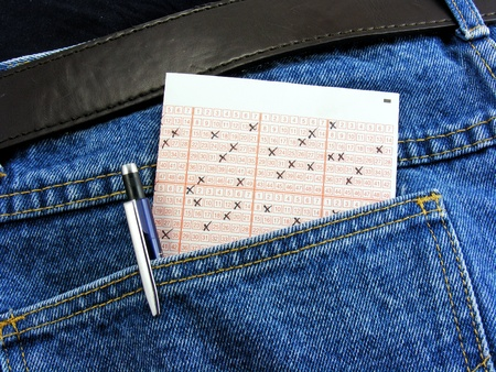 back pocket: A lottery ticket in the back pocket of dark jeans