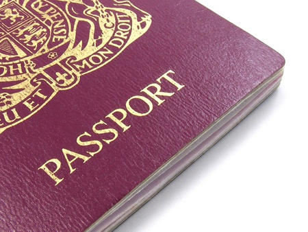 A close up of a British passport on a white background Stock Photo - 10936603