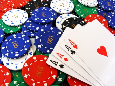 4 aces lying on a pile of vaus valued poker chips Stock Photo - 10989085