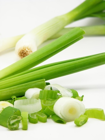 onions: A close up image of spring onions with DOF Stock Photo