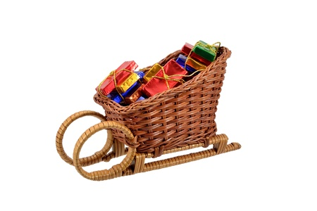 Christmas gift wrapped chocolates in a sleigh Stock Photo - 11049465