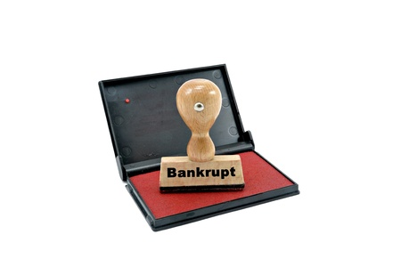 inkpad: bankrupt rubber stamp and inkpad on a white white background