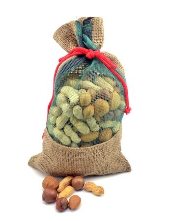 Mixed nuts in hessian bag on white background photo