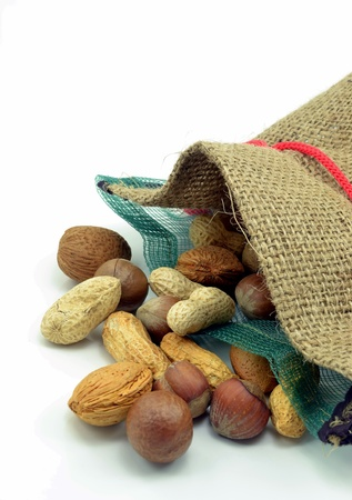 hessian bag: Mixed nuts in an open hessian bag on white background
