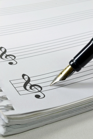 Blank sheet music with fountain pen photo