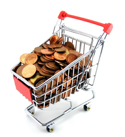 A shopping trolley with coins on a white background photo