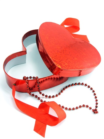 A shiny red love heart gift box with red ribbon & necklace photo