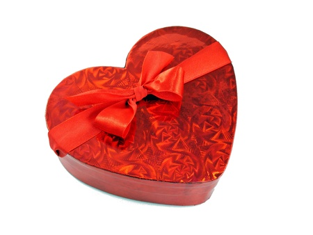 A shiny red love heart gift box with red ribbon