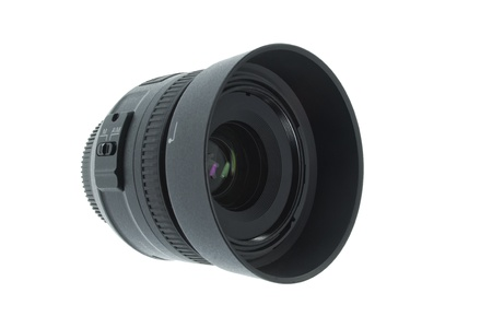 A 35mm camera lens with hood isolated on a white background photo
